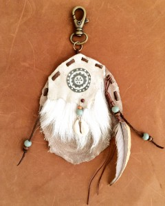 leather, beads and feather