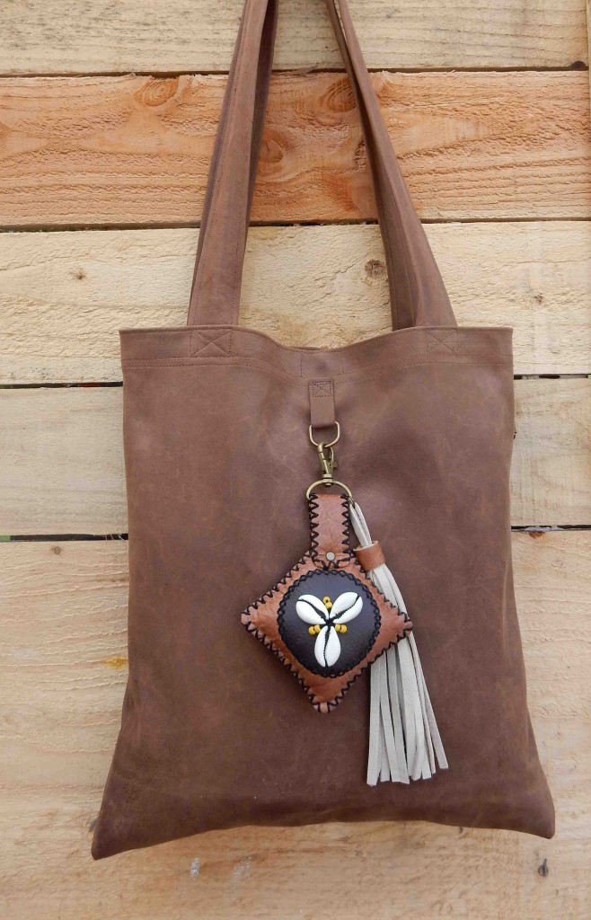 Leather bag and seashell charm