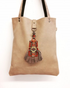 Beige leather bag and charm