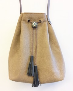 Quality leather bucket bag with concho and tassles