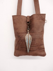 Leather bag with leather charm