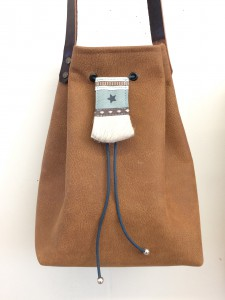 Quality leather bucket bag with boho closure