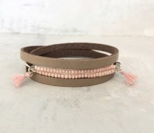 Leather bracelet with powder pink beads and tassles