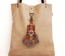 Beige leater bag and charm