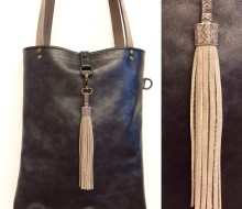 Black leather bag with charm